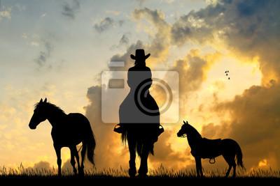 Wall mural girl on horseback at sunset