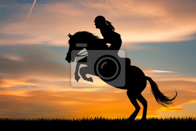 Wall mural girl on horseback at sunset