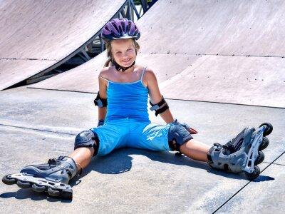 Wall mural Girl riding on roller skates .