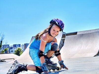 Wall mural Girl riding on roller skates in skatepark.