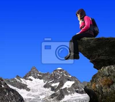 Girl sitting on a rock - Swiss Alps, Europe