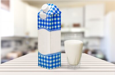 Glass of milk and box on  background
