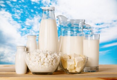 Glass of milk and dairy products on desk