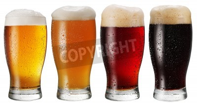 Wall mural Glasses of beer on white background.