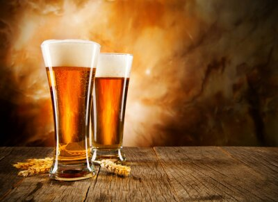 Wall mural Glasses of beer on wooden table
