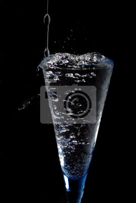goblet with fresh mineral water on black background