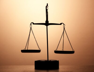 Wall mural Gold scales of justice on brown background