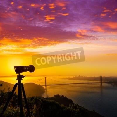 Wall mural Golden Gate Bridge San Francisco sunrise California USA with photo camera silhouette
