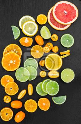 Grapefruit, orange, tangerine, lemon, lime and kumquat on black