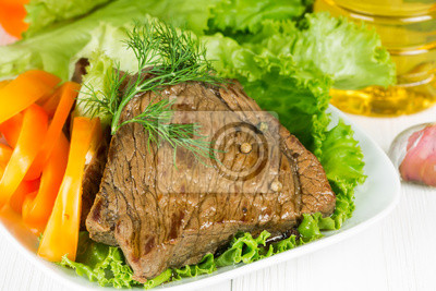 Grilled beef on lettuce leaves