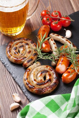 Wall mural Grilled sausages and beer mug