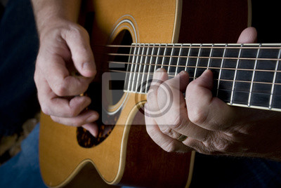 Wall mural Guitar being played by a master guitarist