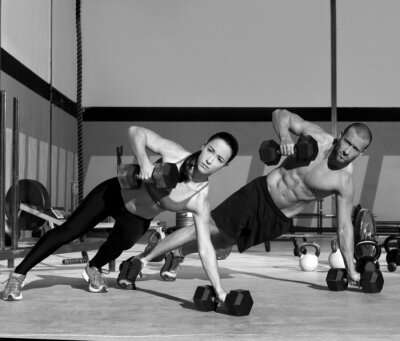 Wall mural Gym man and woman push-up strength pushup