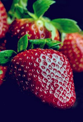 Wall mural Half of strawberry isolated on black background