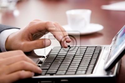Hand above keyboard