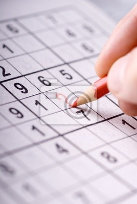 Hand draws a red question mark on Sudoku field .