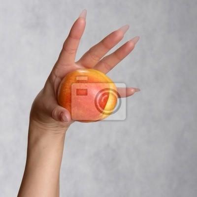 hand with a peach