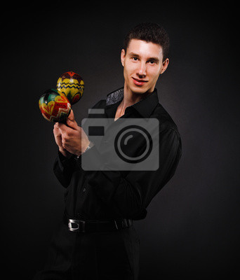 Handsome smiling man with maracas