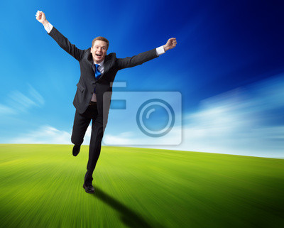 happy business man running on blured spring field