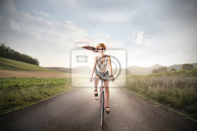 happy girl who is riding a bike