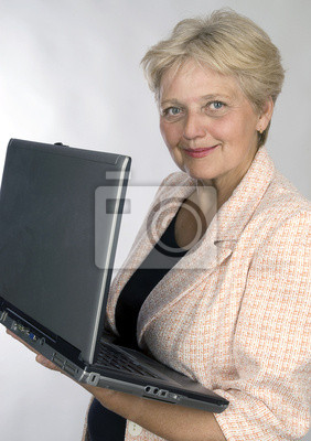 happy older pensioner woman with computer