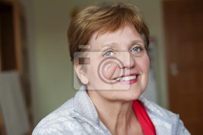 happy senior woman at home - bokeh background