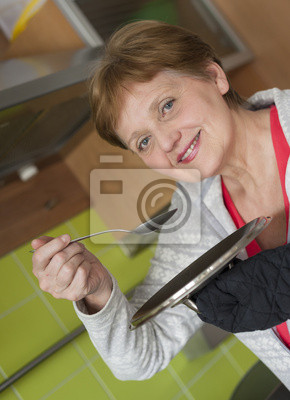 happy senior woman at home - cooking