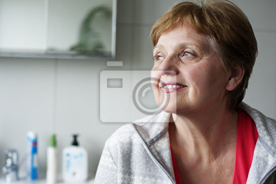happy senior woman at home in the bathroom