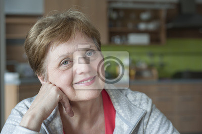 happy senior woman at home relaxing
