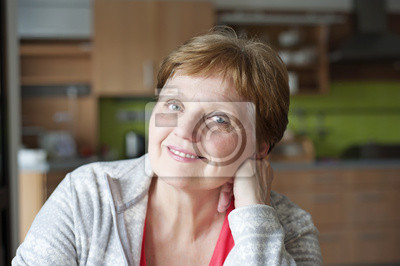 happy senior woman at home relaxing in the kitchen