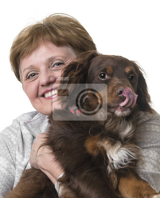 happy senior woman with a dog