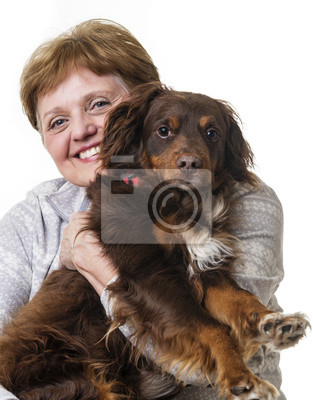 happy senior woman with her dog