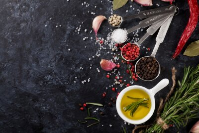 Wall mural Herbs and spices over black stone
