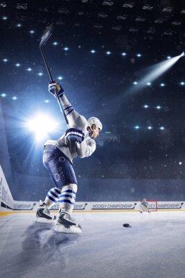 Wall mural Hockey players shoots the puck and attacks