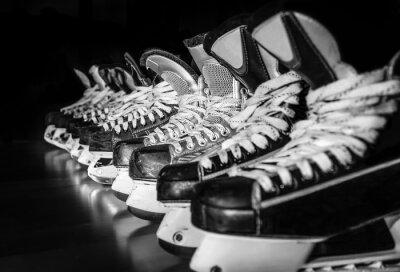 Wall mural Hockey skates lined up in locker room