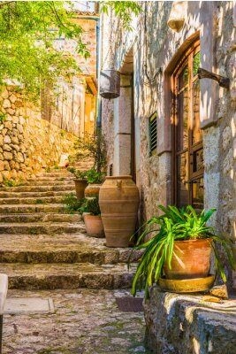 Wall mural Idyllic view of an mediterranean rustic house and stone stairs