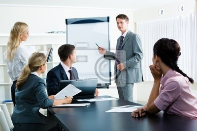 Image of smart business people looking at their leader