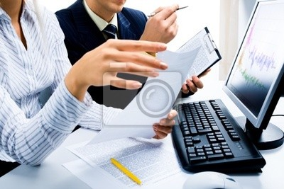 Image of two business partners discussing documents