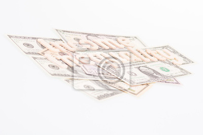 Income inequality wooden letters on US banknotes