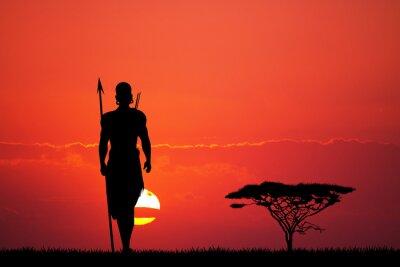 Wall mural Indigenous man at sunset