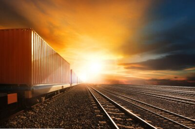 Wall mural industry container trains running on railways track against beau