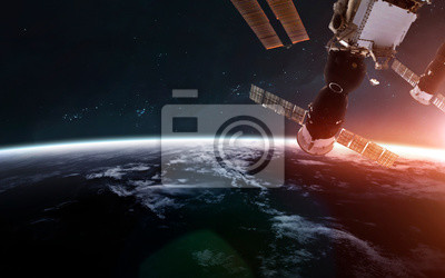 International space station orbiting Earth planet. Science fiction art. Elements of this image furnished by NASA