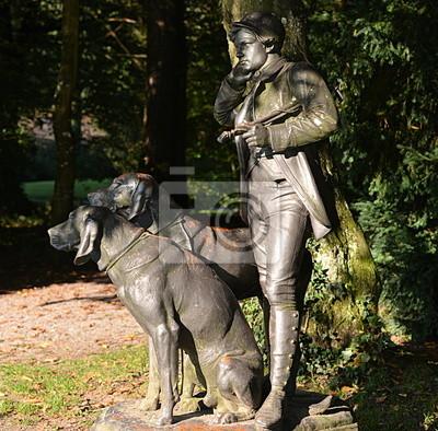 jardin public...sculpture d'un chasseur et de ses chiens