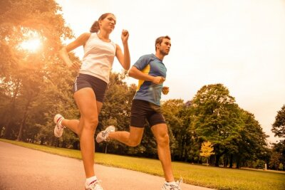 Wall mural Jogging together - sport young couple