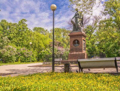Karamzinsky square with blooming dandelions and lilacs in Ulyanovsk (Simbirsk) in  spring