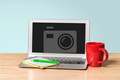 Laptop. Laptop with blank screen and cup on table. Isolated on
