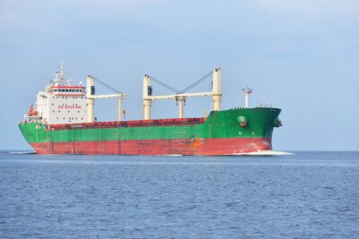 Wall mural Large cargo ship (Bulk carrier) sailing in a bright sunny day. R
