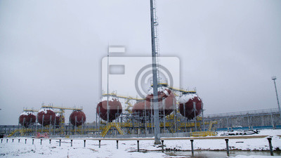 Wall mural Large Industrial tanks for petrol and oil. Large tanks in the chemical factory. Large tanks for storing fuel are outside