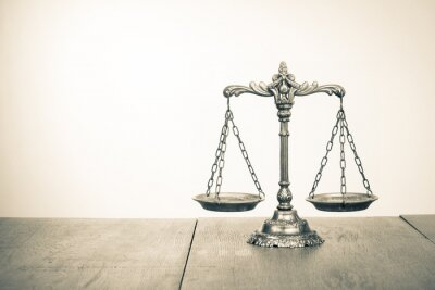 Wall mural Law scales on table. Symbol of justice. Sepia photo