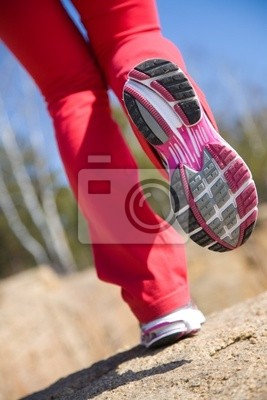 legs of a girl in sneakers